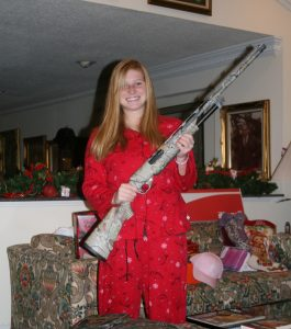 Allie and her gun...one day it will be mom's old gun instead of dad's old gun