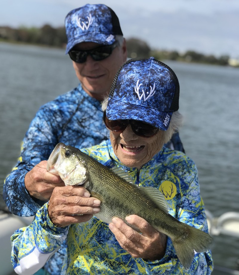 Grandma catches a bass. Fishing is for families