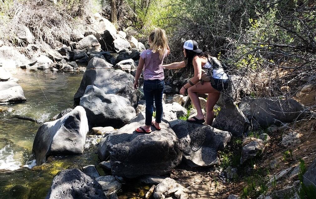 mom teaching girl to fish